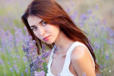 smiling beautuful brunette in the lavender field Banco de Imagens - 14311134