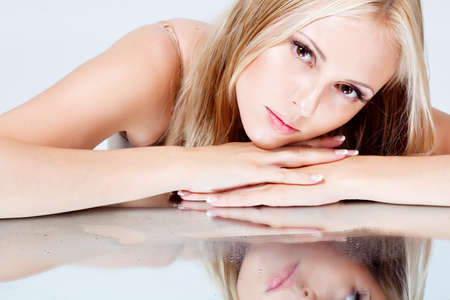 girl with long hair lying on a mirror Stock Photo - 14310826
