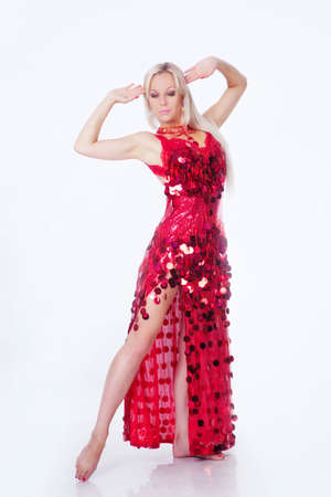 Dancing lady in the red dress isolated on white photo