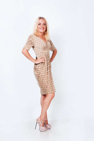 Beautiful blond hair girl isolated in studio photo
