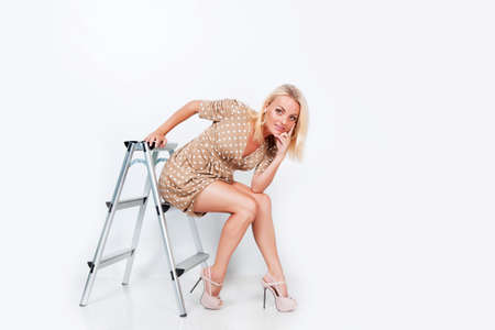 Beautiful blond hair girl isolated in studio photo