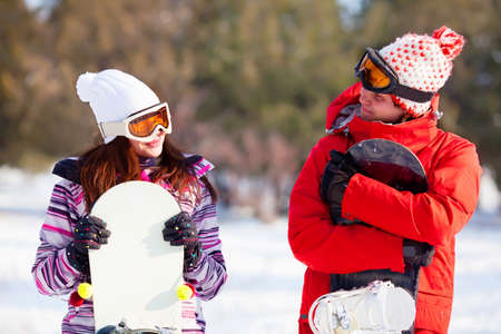 Girl and boy with snowboards Banco de Imagens - 14760287