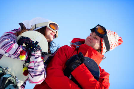 Girl and boy with snowboards photo