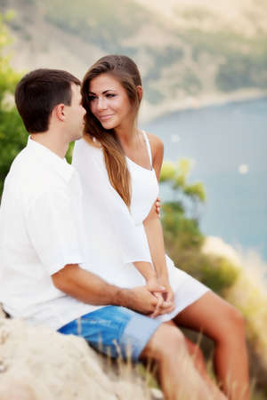 Two lovers near the seashore photo