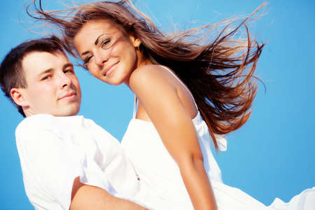 Two lovers with blue sky background photo