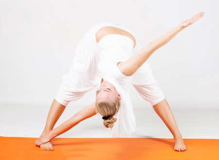 Young woman doing yoga exercise Banco de Imagens - 14977957