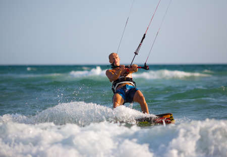 Man with kitesurf on the beach Banco de Imagens