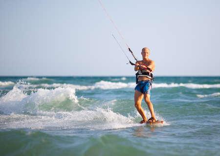 kiter: Man with kitesurf on the beach Stock Photo