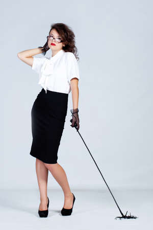 whips: Strict teacher with glasses and a whip