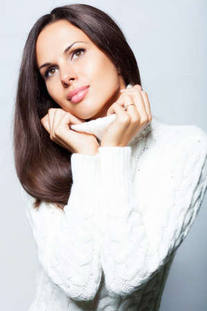 Beautiful brunette woman in studio