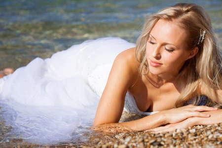 Beautiful bride portrait on the beach photo
