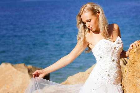 Beautiful bride portrait on the beach photo