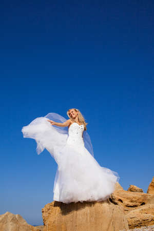 Beautiful bride portrait on the rocks photo