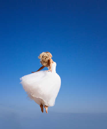 beautiful bride: Beautiful bride jumping to the sky