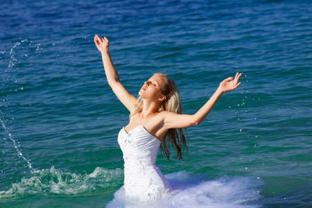 Beautiful bride portrait in the sea photo