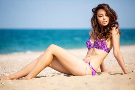 bikini model: Beautiful brunette in bikini on the beach