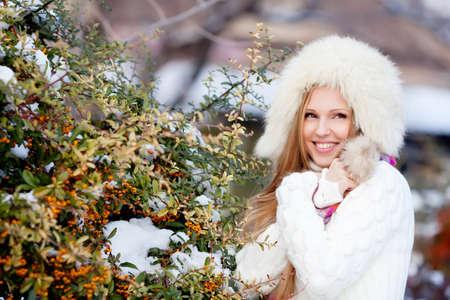 winter garden: Beautiful blondhair girl in winter garden