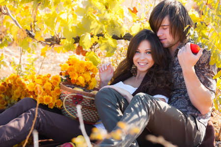 autumn woman: Two lovers on picnic in garden Stock Photo