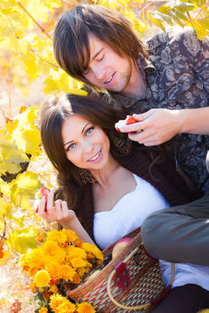Two lovers on picnic in garden photo
