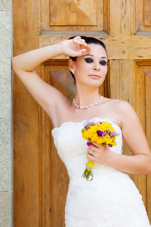 Beautiful brunette bride outdoor portrait photo