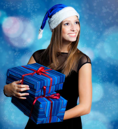 Young woman portrait in studio with presents photo