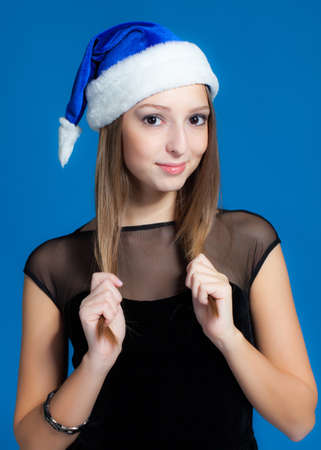 Beautiful brunette girl in christmas hat Stock Photo - 16472640