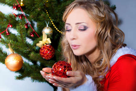 Beautiful blonde portrait with christmas ball  photo