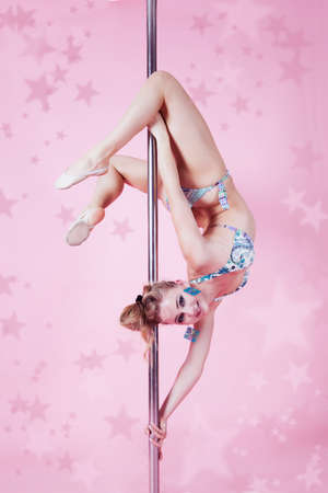 Beautiful girl making figure of poledance photo