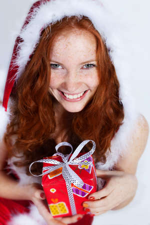 Beautiful redhead girl in christmas dress photo