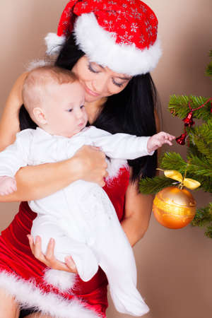 Mother with sun near christmas pine Stock Photo - 16763643
