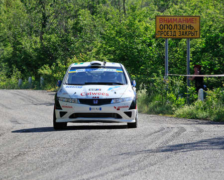 irc: FOROS, UKRAINE - JUNE 4: Martin Kangur driving his car at IRC Prime Yalta-Rally 2011, Foros, Ukraine, 4 june 2011