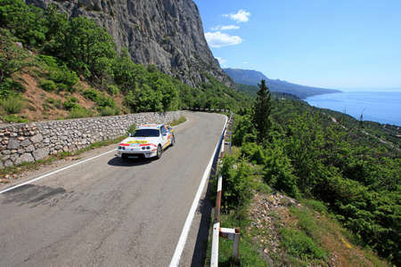 irc: FOROS, UKRAINE - JUNE 4: Oleksandr Panchenko driving his car at IRC Prime Yalta-Rally 2011, Foros, Ukraine, 4 june 2011