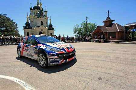 irc: FOROS, UKRAINE - JUNE 4: Guy Wilks driving his car at IRC Prime Yalta-Rally 2011, Foros, Ukraine, 4 june 2011 Editorial