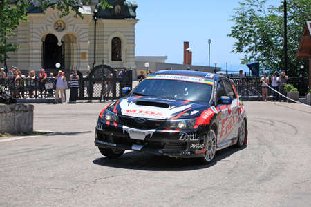 FOROS, UKRAINE - JUNE 4: Anton Kuzmenko driving his car at IRC Prime Yalta-Rally 2011, Foros, Ukraine, 4 june 2011