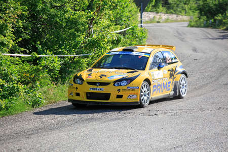 FOROS, UKRAINE - JUNE 4: Oleksandr Saliuk and Evgeniy Chervonenko at 'IRC Prime Yalta-Rally 2011', Foros, Ukraine, 4 june 2011