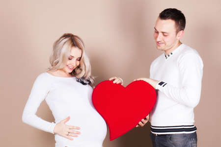 Pregnant woman with husband photo