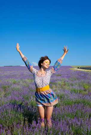 Beautiful girl on the lavender field Stockfoto