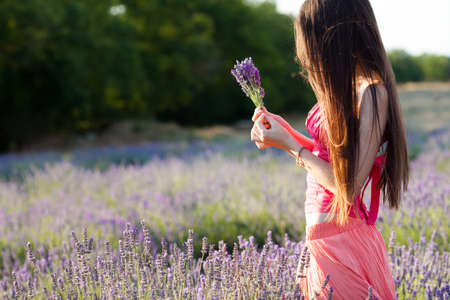 Beautiful girl on the lavender field Banco de Imagens