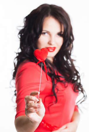 love expression: Girl with red heart in hand