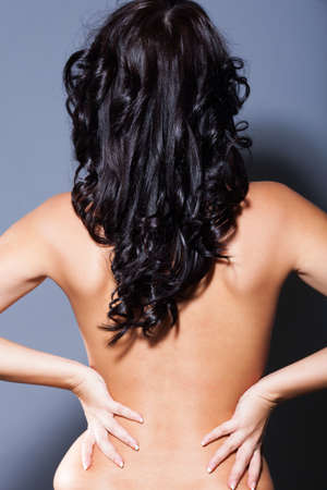Brunette girl back photo in studio photo