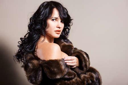 Brunette woman in fur coat Stock Photo - 17499697