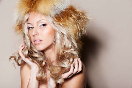 Blond hair woman in fur hat photo