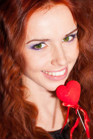 Beautiful girl with red heart in hand Stock Photo - 17499693