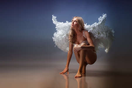 Beautiful woman with angel wings in white underwear  photo