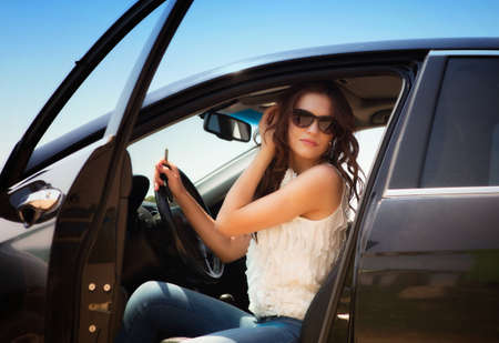 Young woman sitting in the car photo