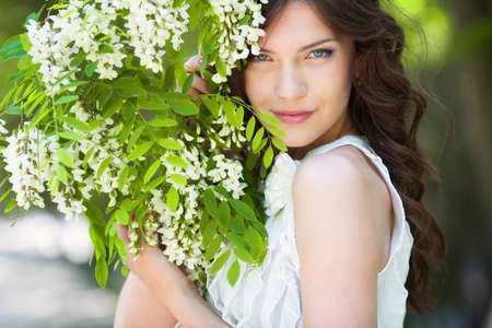 Young woman in blooming garden