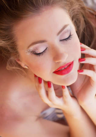 Young woman portrait with bright makeup photo