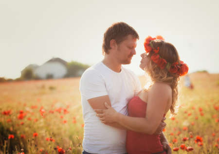 Two lovers on the poppy meadow photo