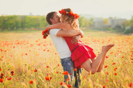 Two lovers on the poppy meadow