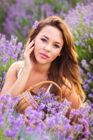 Beautiful girl with long hair on lavender field Stockfoto